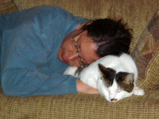 sleepy woman using sleepy cat as a pillow
