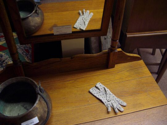 striped and spotted glove on an antique vanity