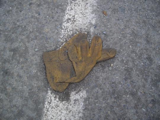 tan leather work glove on a fog line
