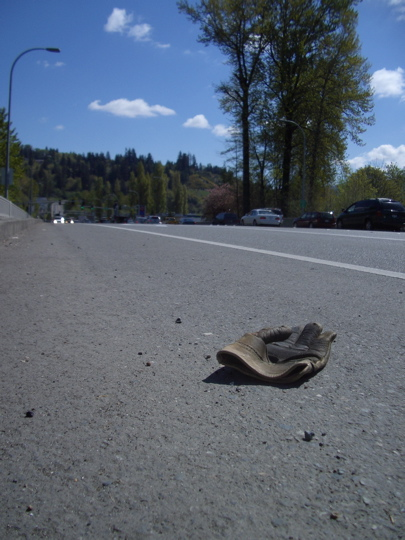 leather work glove in a bike lane