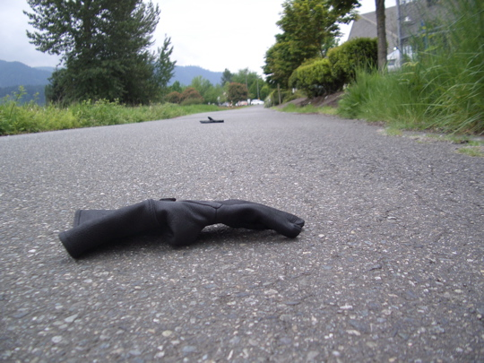 nice black leather motorcycle gloves in the middle of the road