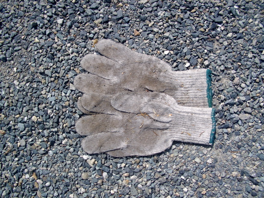 pair of knit cotton gloves, palms up, thumbs and index fingers overlapping