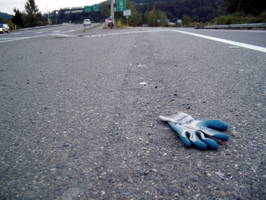rubberized canvas glove on a freeway onramp