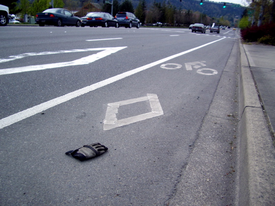 glove in the middle of a bike lane